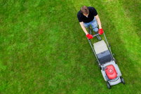 Man mowing lawn, shot from over head.