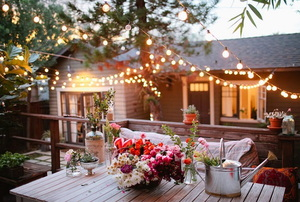 backyard with beautiful lighting and decor