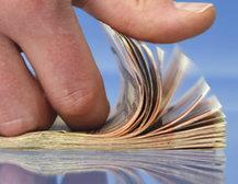 Man's hand flipping cash
