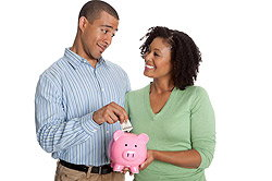 Couple holding a piggy bank