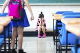 bullied child crying