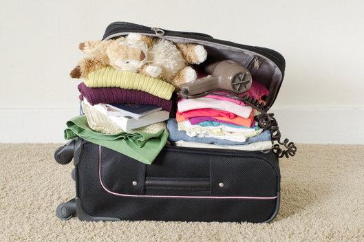 overstuffed suitcase