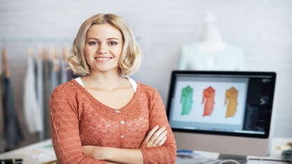 A female fashion designer and business owner.