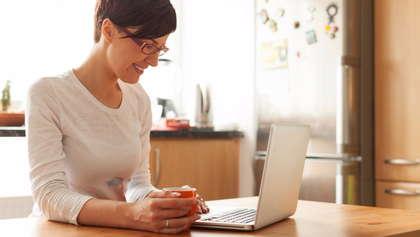 An online teacher working on a computer.