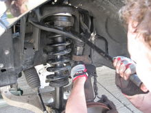 Helpful hint!!!  If ball joint must be completely removed...use jack handle as leverage to pry down upper control arm to reassemble ball joint.  Now just replace lower strut bolt/nut & lower sway bar nut!  Enjoy!!!