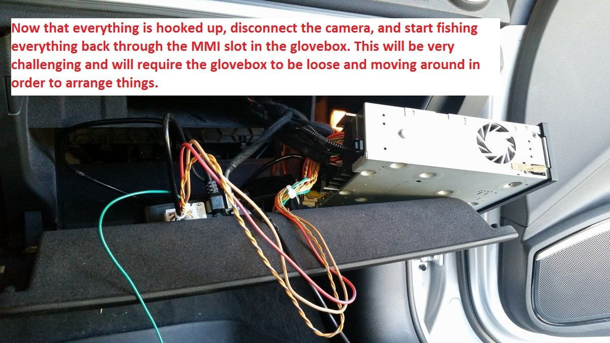 Feed the wiring through the MMI slot in the glove box.