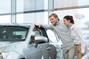couple looking at a vehicle, car shopping