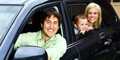 happy family in SUV, family sitting in car