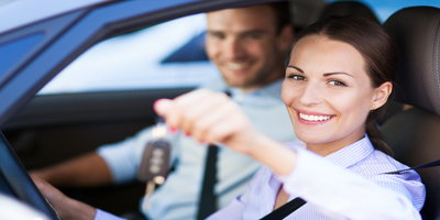 What's the difference between a co-signer and a co-buyer in a bad credit auto loan?