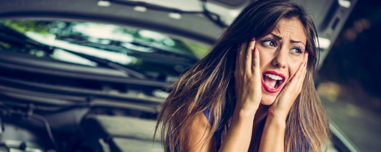 dismayed woman with car trouble