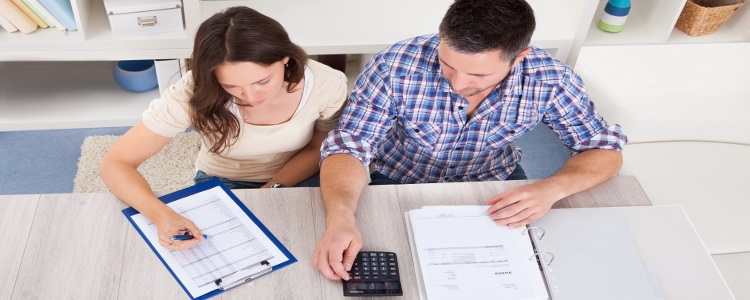couple calculating their budget