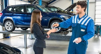 dealership service department, mechanic giving keys to customer