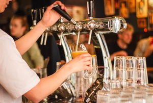 Beer being poured from a tap