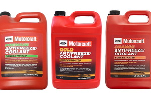 three red bottles of coolant