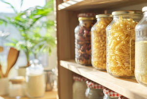 organized pantry with food goods stored in jars