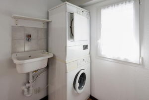 A stackable washer dryer.