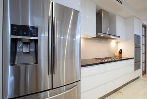 A fridge in a kitchen.