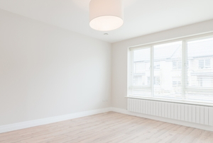 a white empty room with wood floors