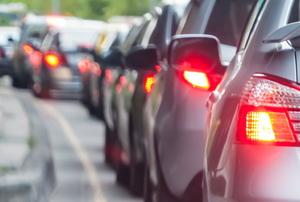 line of cars brake lights in a traffic jam