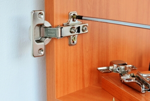 screwdriver fixing cabinet hinges