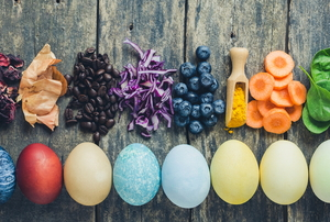 a line of colorful Easter eggs with natural dye products