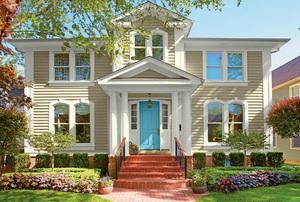 home in spring with blue front door