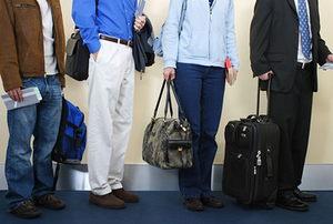 Passengers Waiting To Board Airplane