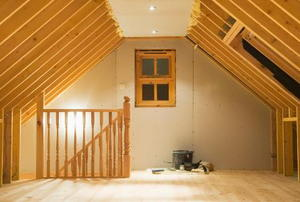 An attic in the middle of a conversion project.