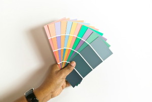 A handful of paint color sample cards.
