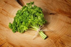 Parsley herbs on wood.