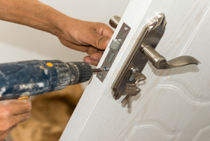 installing a lock on a white door