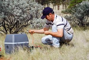 Man setting up camping refridgerator