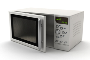 A white microwave with the door left slightly open.