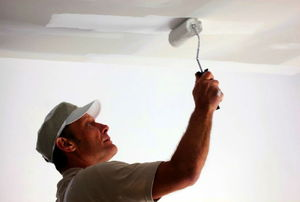 Painting a textured ceiling.