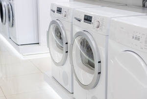 row of white washers and dryers