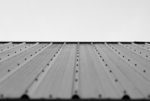 The finished surface of a plain tin roof.