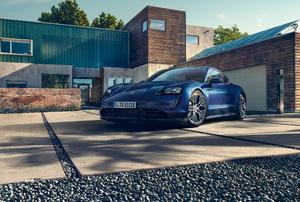 A blue car in a driveway.