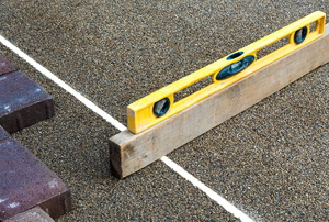 level measuring grade of ground for paver stones