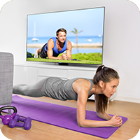 image of woman exercising at home.