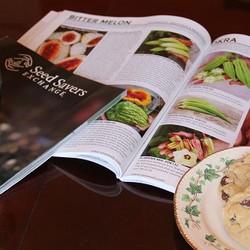 garden catalogs and mug of tea