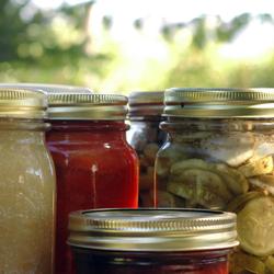 Sealed glass jars of fruit and vegetable preserves