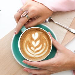 Person enjoying a cup of coffee