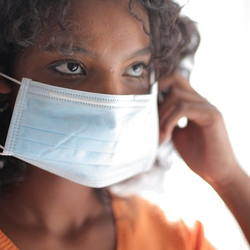 Woman putting on a surgical mask