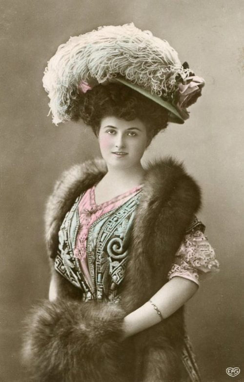 vintage portrait of woman in feathered hat
