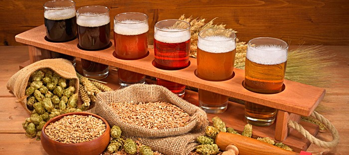 display of different beers with ingredients
