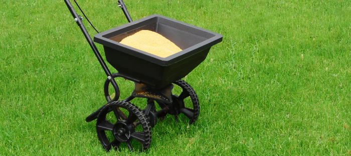 Wheeled Seed Spreader on Grass