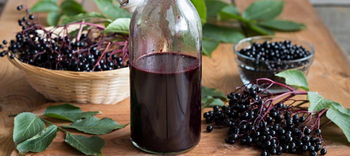Elderberries in Baskets with Elderberry Juice