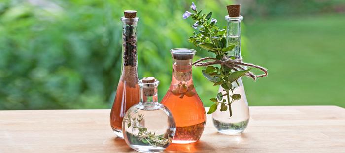 Bottles of herb infused vinegar