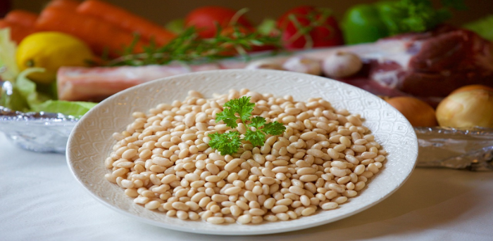 cooked white beans in bowl on table