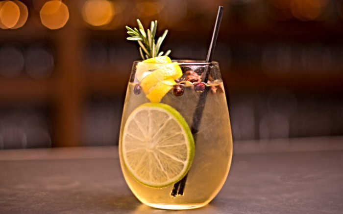 cocktail with lemon and herbs